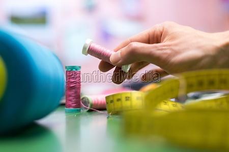 dressmaker workshop close up of measuring