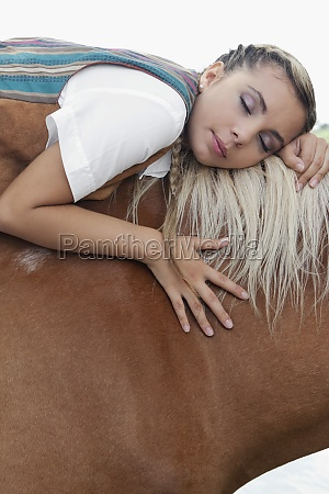 woman napping on a horse