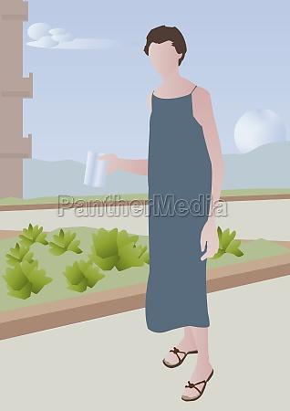woman standing outdoors holding a sheet
