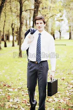 businessman carrying a briefcase in a