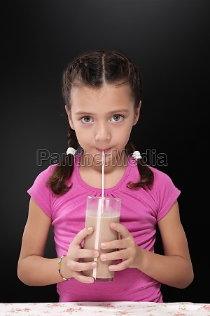 portrait of a girl drinking chocolate