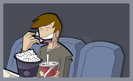 boy eating popcorns in a movie