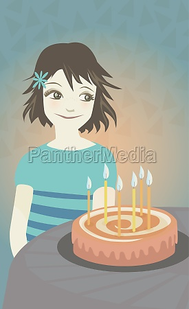 girl looking at a birthday cake