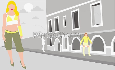 two women standing on the street