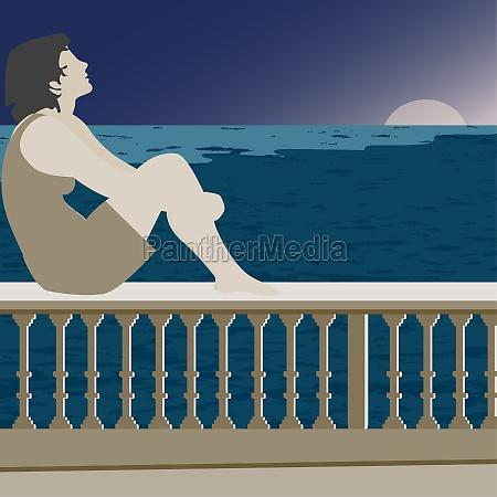 woman sitting on a railing