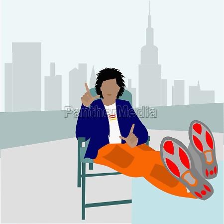 man sitting on a chair gesturing