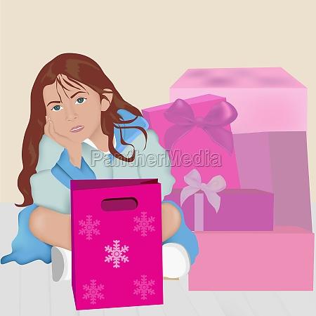 girl lying near christmas presents