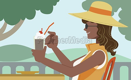 young woman holding an ice cream