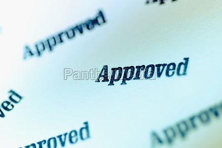 closeup of text approved on a