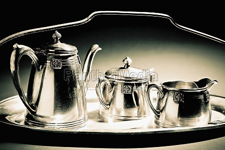 closeup of kettles on a tray