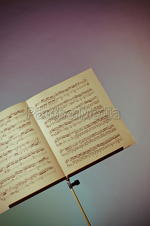 musical notes written in a book