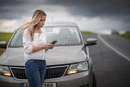 pretty midle aged woman having car