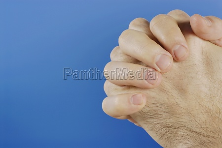 two hands clenched together