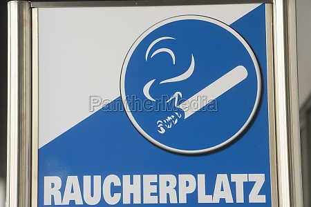 smoking area sign with cigarette