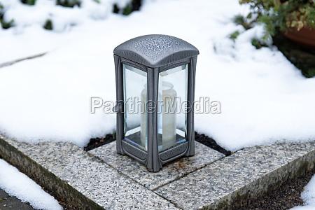 grave lantern on a marble surround