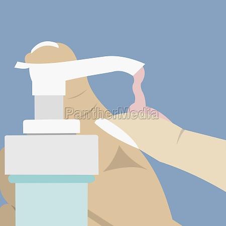 personZs hand using a soap dispenser