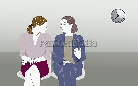 two young women talking to each