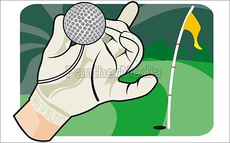personZs hand holding a golf ball