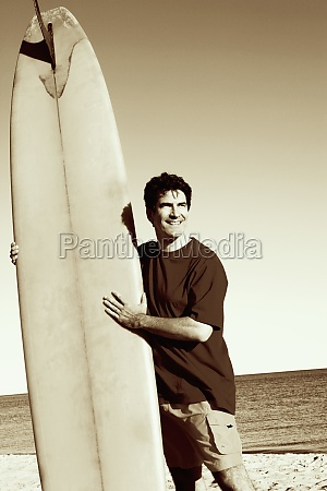 mature man standing on the beach