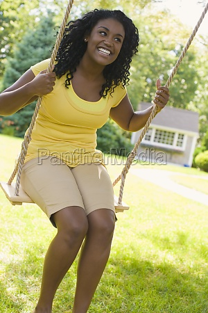 young woman swinging on a swing