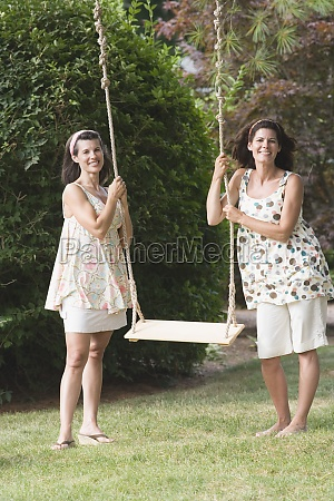 two mature women holding a rope