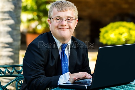 young handicapped businessman working with laptop