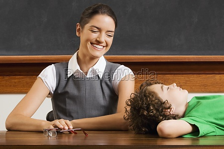 schoolboy lying on a table with