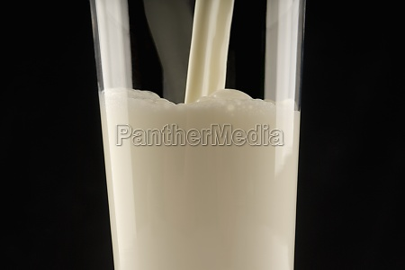 milk being poured in a glass