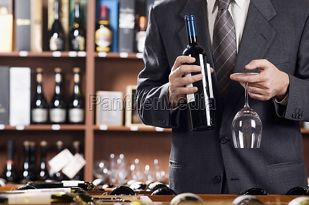 businessman holding a wine glass and