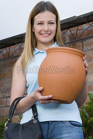 customer holding a decorative urn