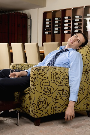 drunk businessman sitting in an armchair