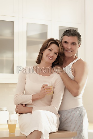 couple drinking juice and romancing in