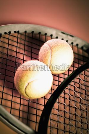 closeup of tennis balls and tennis