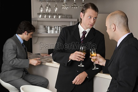 businessmen toasting with wine in a