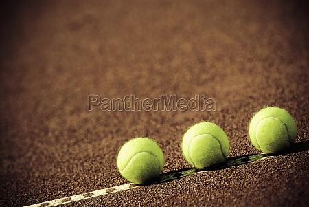 closeup of three tennis balls in