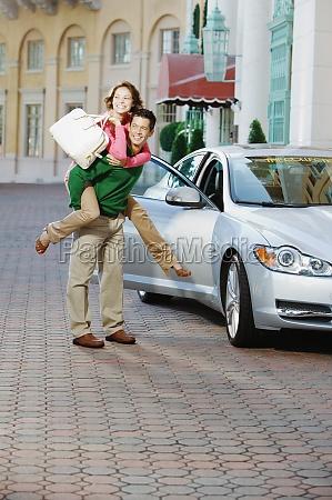 man giving piggyback ride to his