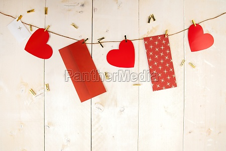 red hearts and envelopes hanging on