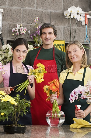 two female florists with a male
