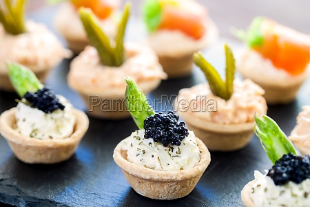 multiple mini puff pastry tartlets with