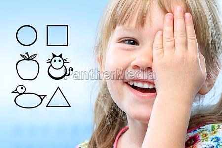 kid testing vision with symbols