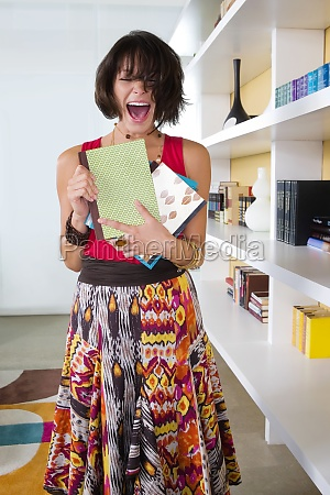 young woman holding books and shouting