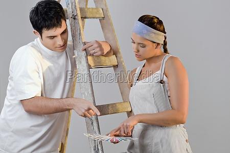 closeup of a young couple choosing