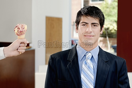 businessman smiling in an ice cream
