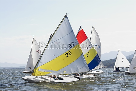 two people participating in a sailboat