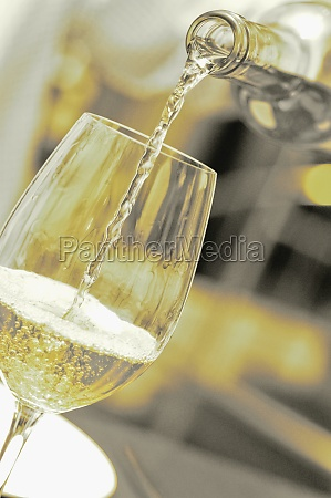 closeup of wine being poured into