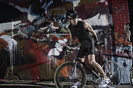 man cycling in the street