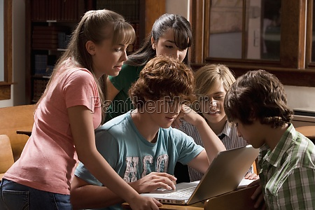 students working on a laptop in