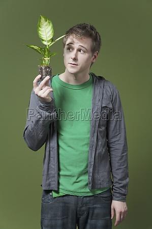 man holding a seedling