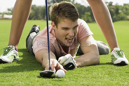 couple playing golf in a golf