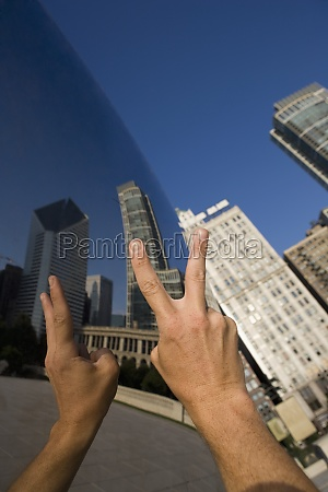 person showing a peace sign in